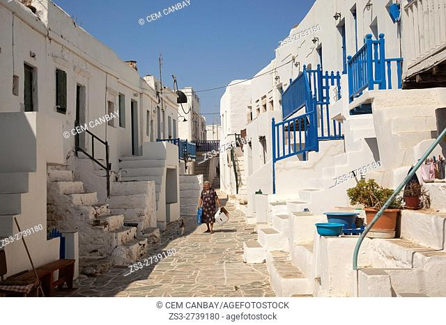 Local woman with her cat at the street in Kastro-Castle area at the old town Chora, Folegandros, Cyclades Islands, Greek Islands, Greece, Europe