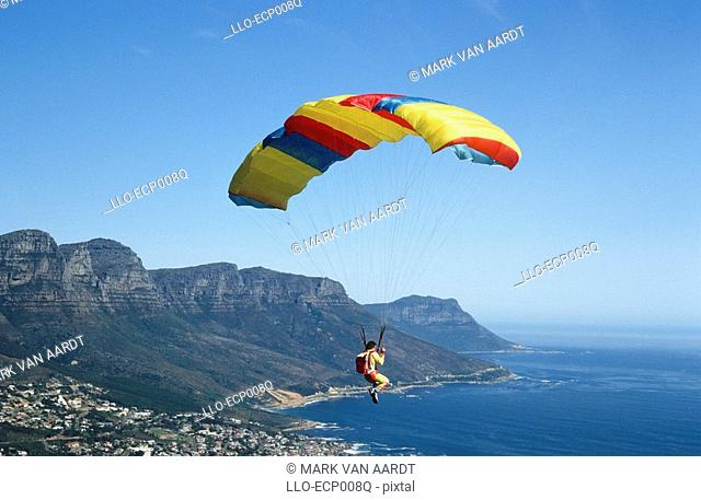 A Paragilder in Flight with the View of Cape Town Below  Cape Town, Western Cape Province, South Africa