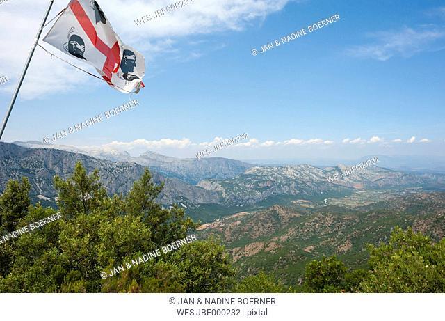 Italy, Sardinia, Supramonte mountains with Sardinian flag