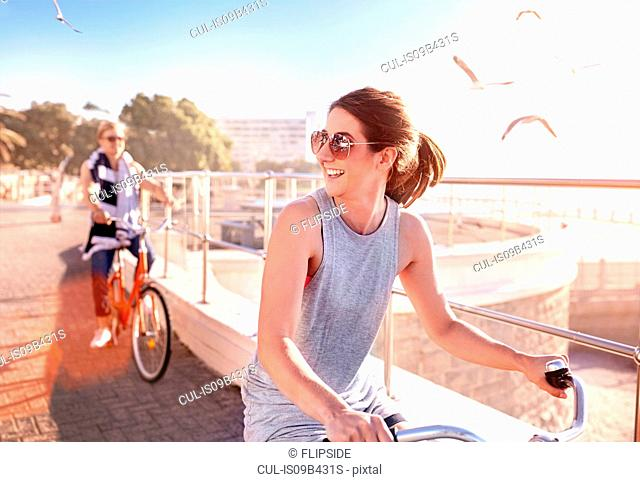 Woman riding bicycle on promenade