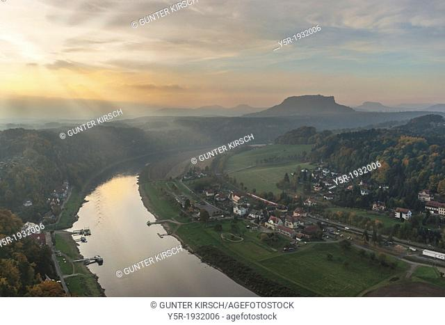 View from the spectacular rock formation Bastei (Bastion) in the national park Saxony Switzerland to the health resort Rathen near Dresden and to Elbe River