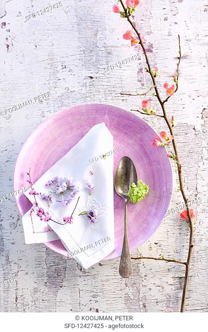 A Spring table setting on a white background