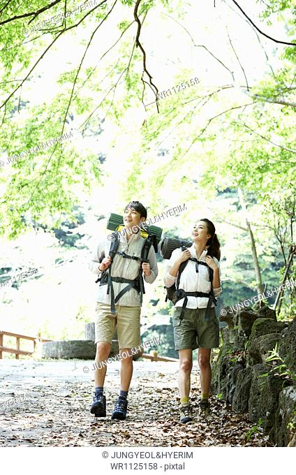 a couple hiking in the woods