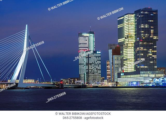 Netherlands, Rotterdam, Erasmusbrug bridge and new commerical towers at the renovated docklands, dusk