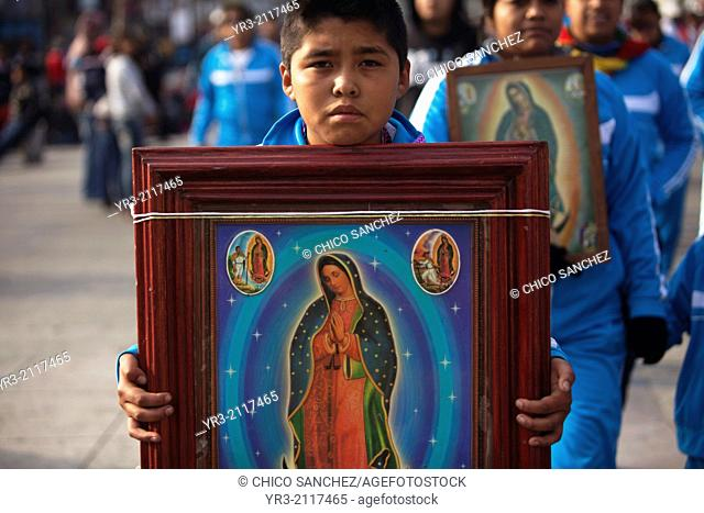 A young pilgrim holds an image of the Virgin of Guadalupe at the pilgrimage to Our Lady of Guadalupe Basilica in Mexico City, Mexico, December 10, 2013