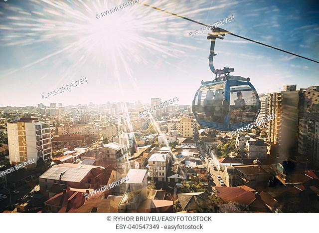 Batumi, Adjara, Georgia. Sun Shining Through Window In Aerial Lift Cableway In Sunny Summer Day. Pendant Road Is Local Landmark