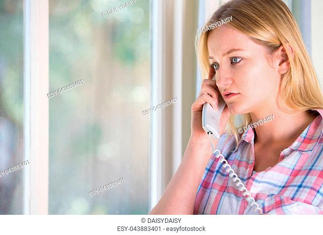 Anxious Young Woman Phoning Helpline