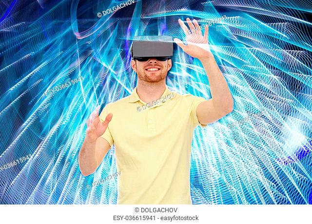 3d technology, virtual reality, entertainment and people concept - happy young man with virtual reality headset or 3d glasses playing game over spiral neon...