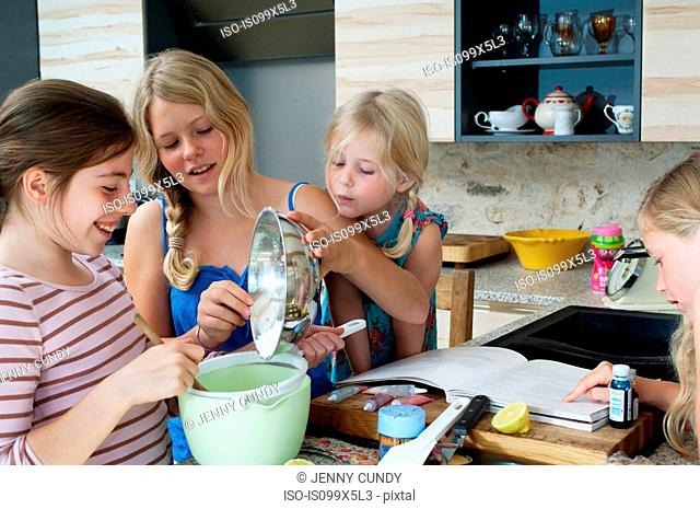 Four girls baking in kitchen