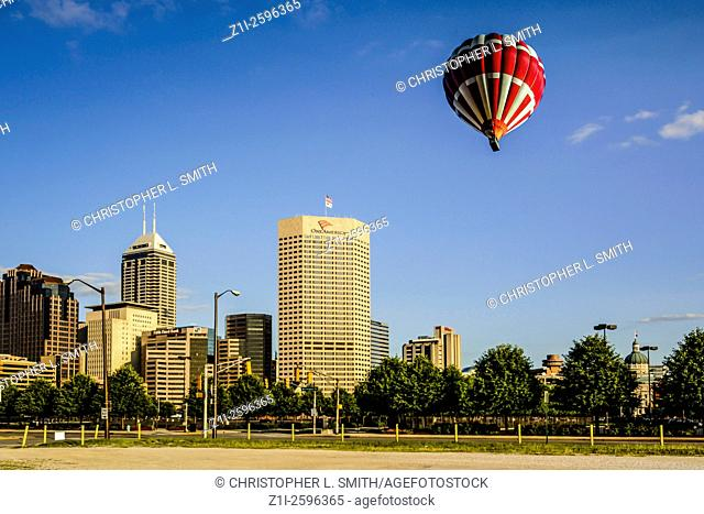 The Indianapolis skyline with a hot air balloon drifting across the city