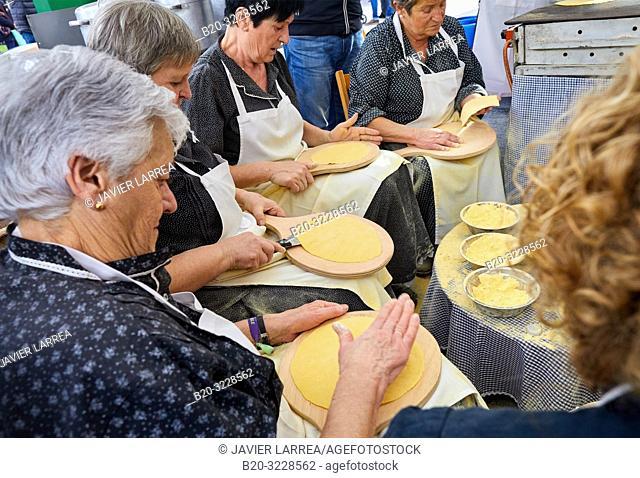 Elaboration of Talos (Cakes with corn flour), People dressed in typical baserritarra clothes, Fair of Santo Tomas, Donostia, San Sebastian, Gipuzkoa