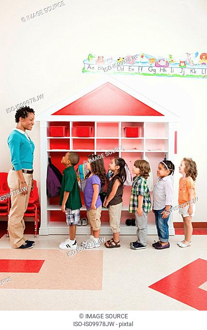 Teacher and children lining up