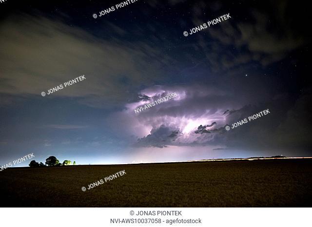 Thunderstorm with sheet lightning under the starry sky near Butzbach, Hessia, Germany