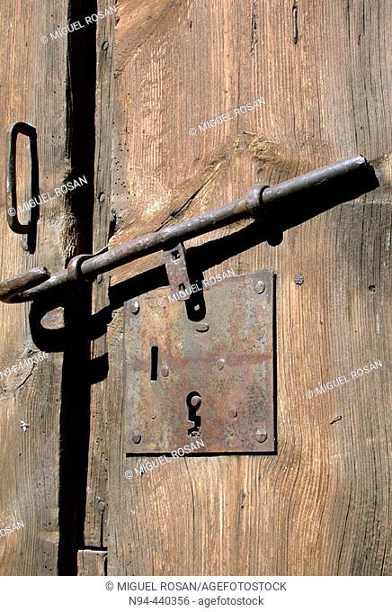 Old lock on an old wooden farmyard