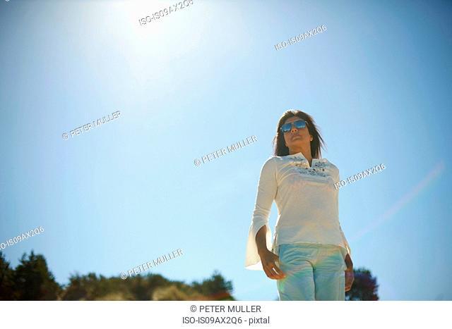 Woman under hot sun