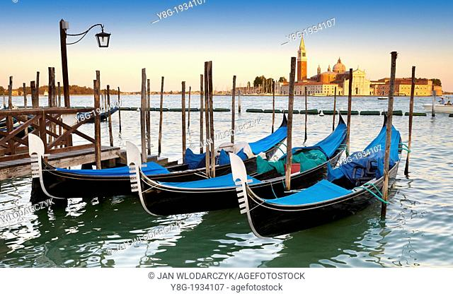 Venice - Grand Canal (Canal Grande), venetian gondola at the pier on Canal Grande, Venice, Italy, UNESCO