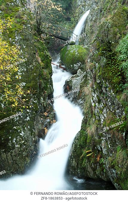 Waterfall with bridge at Estrela Mountain Natural Park, Portugal