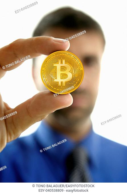 Businessman holding Bitcoin currency in hands on white background