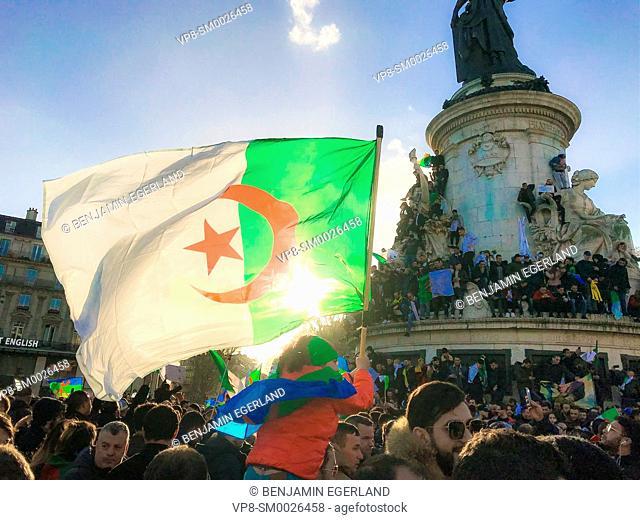 10, 000 Algerian-origin protesters join Algeria demonstration protesting against President Abdelaziz Bouteflika. At place de la Republique in Paris, France