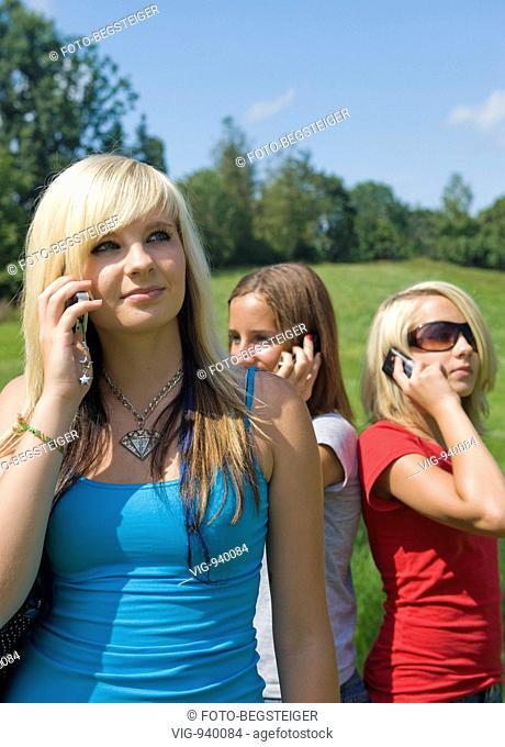 teenage girls using mobile phones. - 14/07/2008
