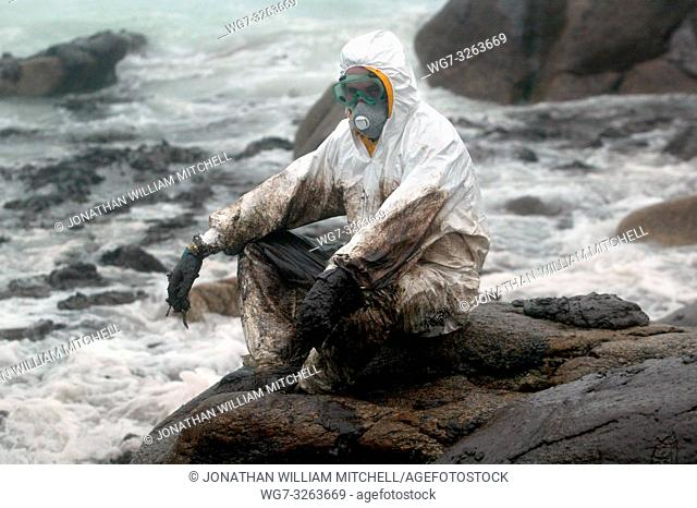 SPAIN Carnota -- 14/12/2002 -- Soldier rests while cleaning heavy fuel oil from rocks in Carnota. Thousands of tonnes of heavy fuel oil which has leaked from...