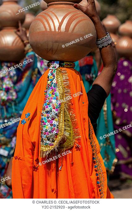 Abhaneri, Rajasthan, India. Multicolored Sequined Headdress of a Woman Walking to a Bride's House in a Pre-wedding Celebration