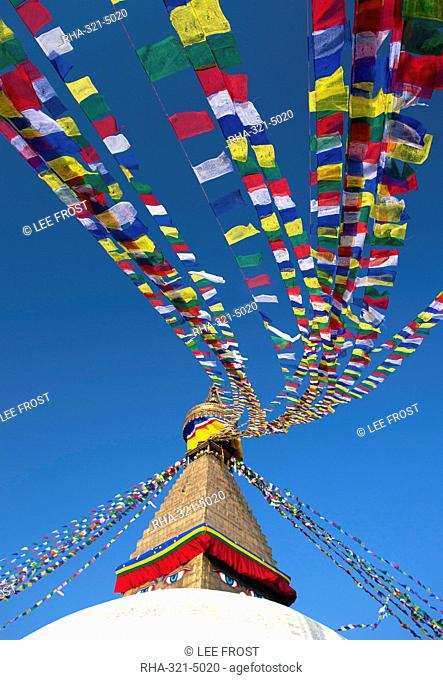 Bodhnath Stupa Boudhanth Boudha, one of the holiest Buddhist sites in Kathmandu, UNESCO World Heritage Site, with colourful prayer flags against clear blue sky