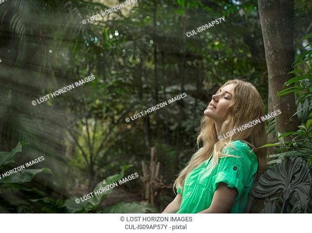 Woman relaxing in forest