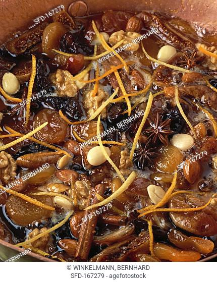 Bottled dried fruit with nuts, almonds and spices