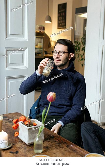 Man in a cafe with Latte Macchiato
