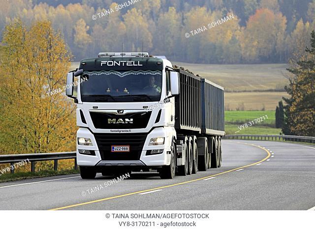 Salo, Finland - October 13, 2018: White MAN TGX 35. 580 truck of Fontell Granite Ltd in seasonal sugar beet haul along autumnal highway in Finland