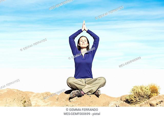 Bolivia, Salar de Uyuni, woman relaxing