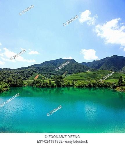 clear lake surrounded by mountains