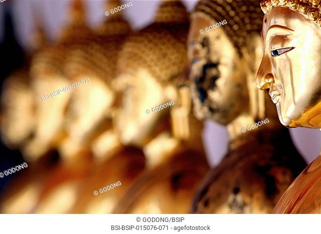 Seated Golden Buddha statues in a row at Wat Pho (Temple Of The Reclining Buddha), Bangkok