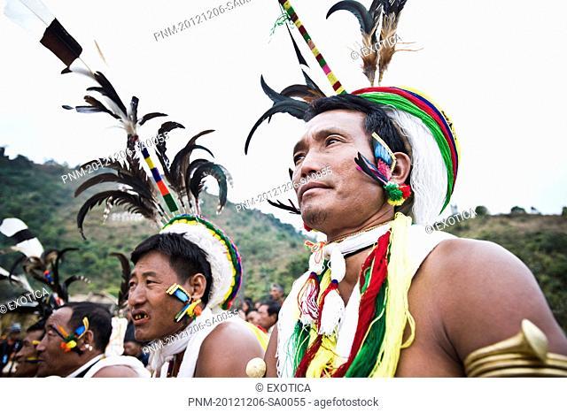 Naga tribal men dancing in traditional outfit, Hornbill Festival, Kohima, Nagaland, India