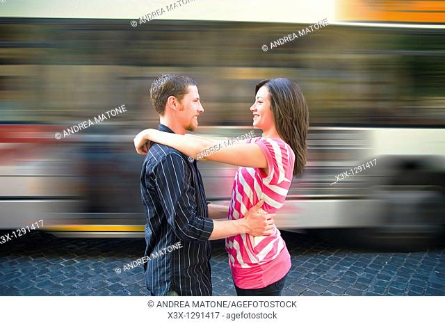 Young couple embracing at train station