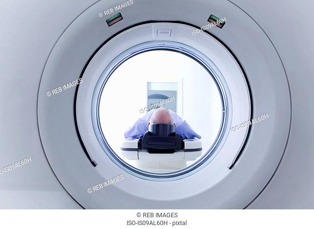 Patient lying down on CT scanner
