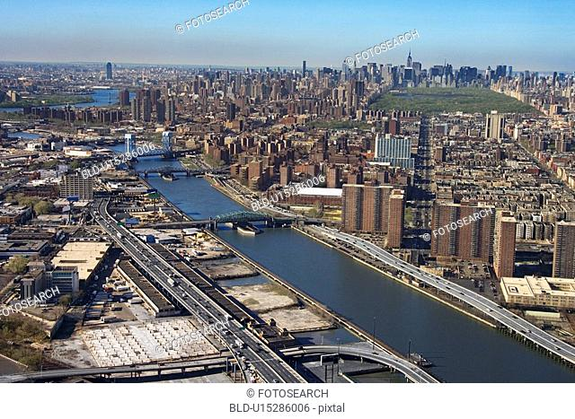 Aerial view of Harlem River and bridges with the Bronx and Manhattan buildings in New York City