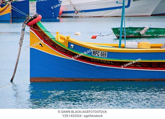 Traditional Maltese 'luzzu' fishing boat with the eye of Osiris to help ward off evil spirits  Marsazlokk Bay, Malta