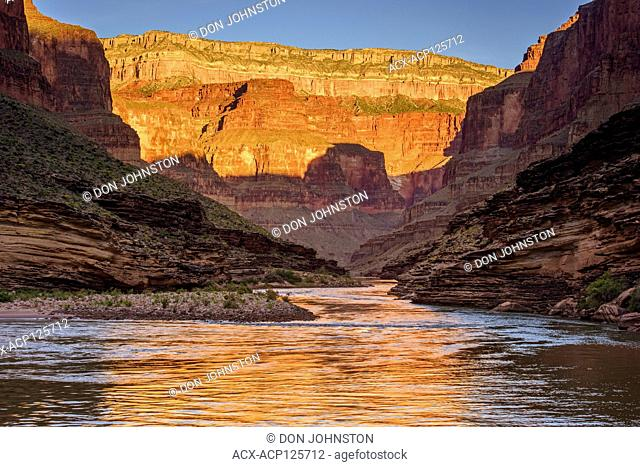 Dawn light reflecting off the Grand canyon walls into the Colorado River from Conquistador Isle (Mile 121), Grand Canyon National Park, Arizona, USA