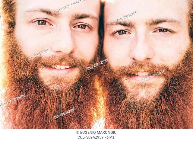 Close up portrait of young male hipster twins with red beards