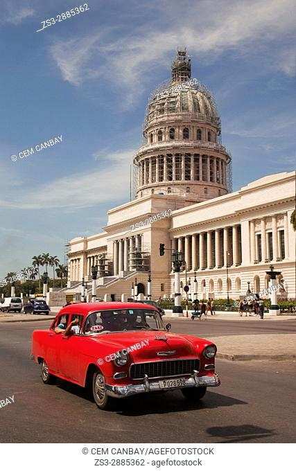 Old American car used as taxi in front of the Capitolio building in Central Havana, Cuba, West Indies, Central America