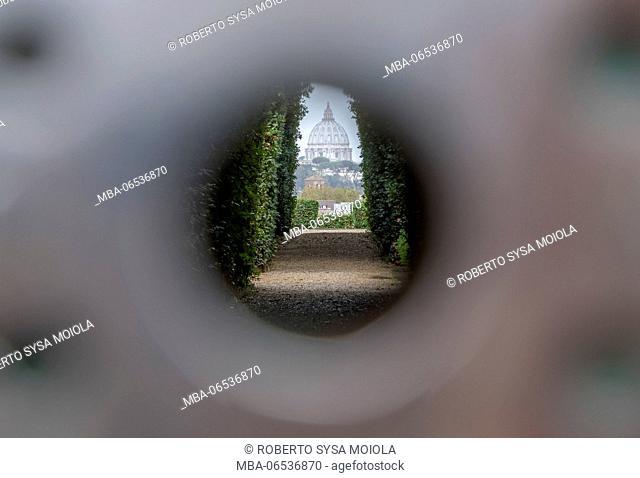 View of the Basilica di San Pietro from the hole of Porta Cavalieri di Malta Rome Lazio Italy Europe
