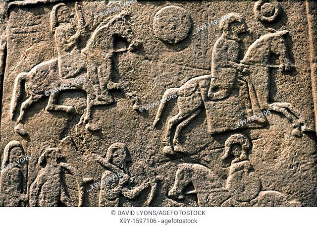 Celtic Pictish symbol stone slab detail in Aberlemno churchyard, Tayside, Scotland  Battle scene with horse cavalry and spearmen
