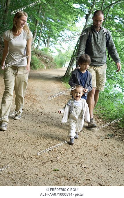 Family hiking in woods