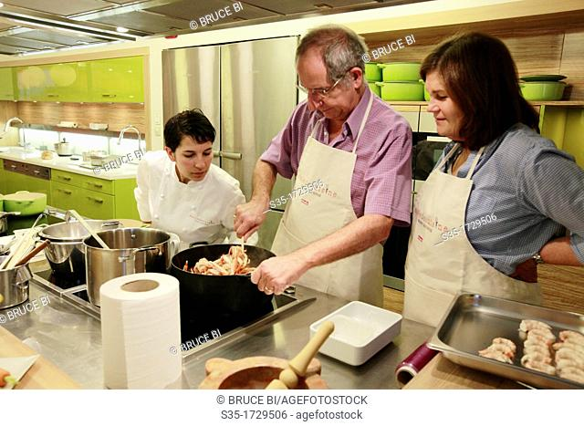 A cooking class giving by Alain Ducasee trained chef Sabrina Zoli in Ecole de Cuisine Alain Ducasse (Alain Ducasse cooking school), Paris, France