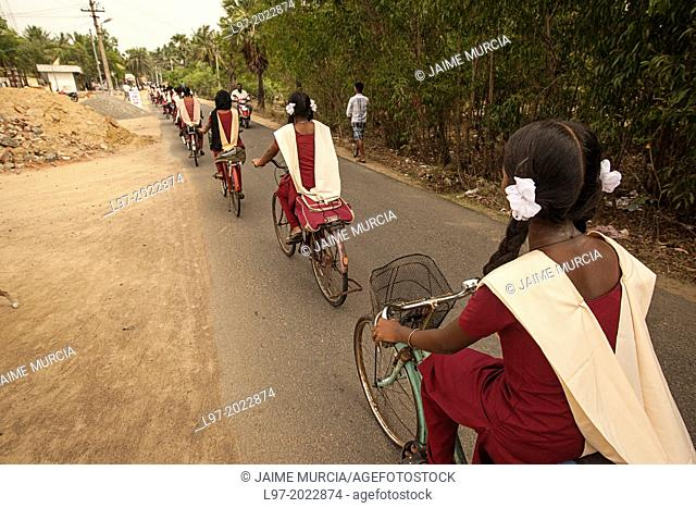 Girls riding bikes to school, Tamil Nadu state, southern India
