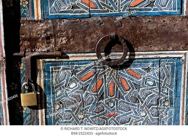Blue painted door in the Le Jardin des Biehn a riad small hotel in the Medina of Fez