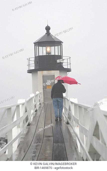 Marshall Point lighthouse, woman, red umbrella, rain, fog, Port Clyde, Maine, New England, USA