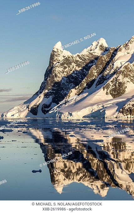 Reflections in the calm waters of the Lemaire Channel, Antarctica